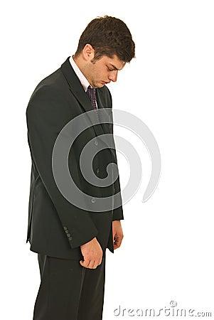 Unhappy business man walking
