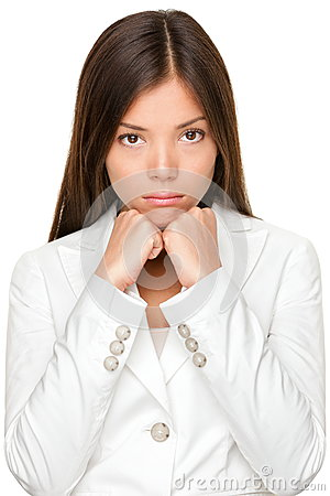 Unhappy Businesswoman With Hands On Chin