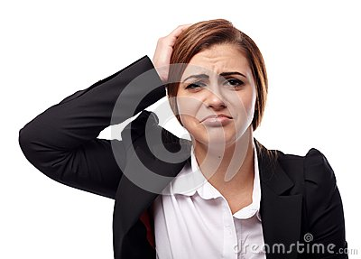 Unhappy businesswoman with hands on head