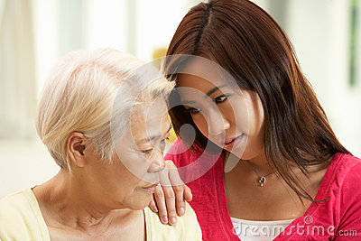 Unhappy Chinese Mother Being Comforted By Daughter