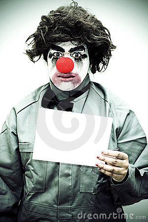 Unhappy Clown Holding Sign