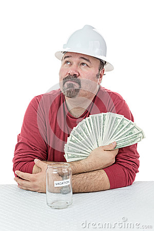 Unhappy construction worker holding to tax money
