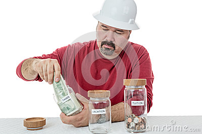 Unhappy Construction Worker Paying The Taxes Stock ...