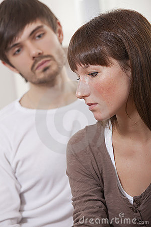 Unhappy couple at home