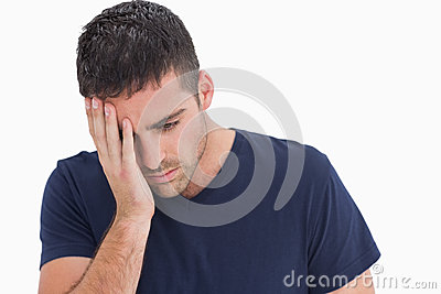 Unhappy man with head in hand