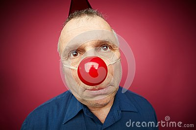 Unhappy man with red nose