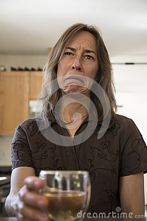 Free Unhappy Middle Aged Woman In The Kitchen Drinking Wine Royalty Free Stock Image - 41492536