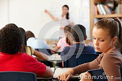 Unhappy schoolgirl in class