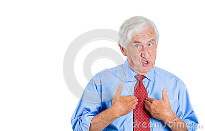Unhappy senior man, executive, grandpa, pointing at himself as if to say, you mean me, you talking to me?