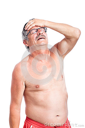 Unhappy senior man with headache
