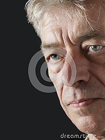 Unhappy Senior Man Looking Away