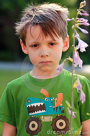 Stock photo unhappy somber little 5 year old boy