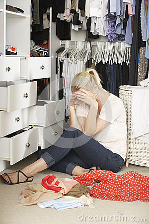 Free Unhappy Teenage Girl Unable To Find Suitable Outfit In Wardrobe Royalty Free Stock Image - 54966436