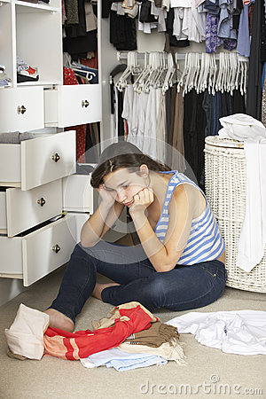 Free Unhappy Teenage Girl Unable To Find Suitable Outfit In Wardrobe Royalty Free Stock Image - 55895386