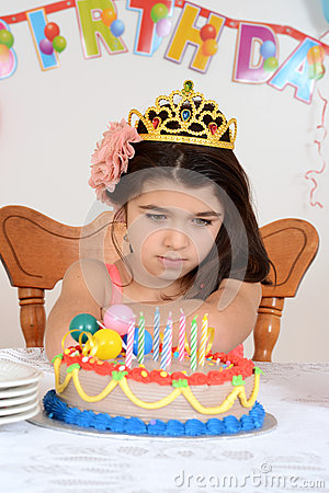 Unhappy young birthday girl child