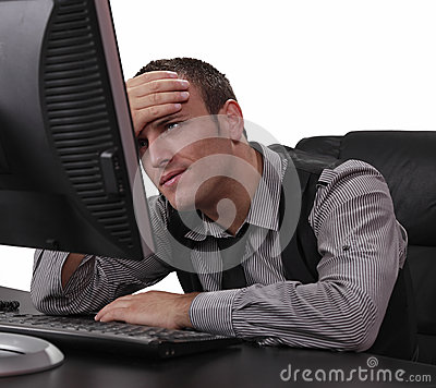 Unhappy Young Man in Front of the Computer