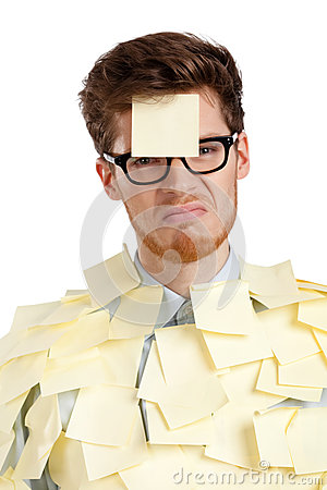 Unhappy young man with a sticky note