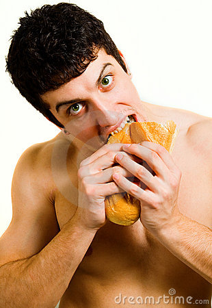 Unhealthy food - hungry man eating bread