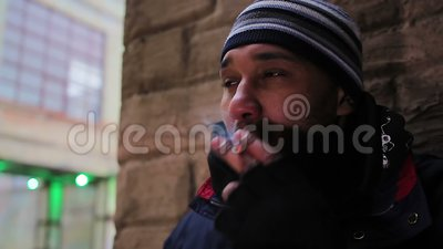 Unhealthy lifestyle. Man smoking in public place. Offense against the law. Stock footage stock video footage