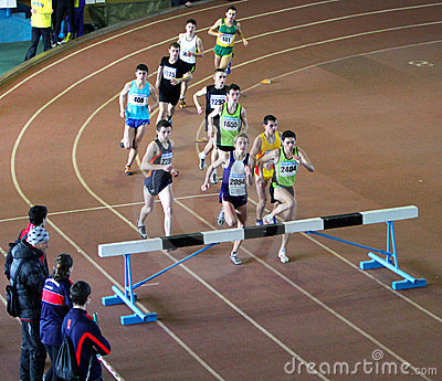 Unidentified boys run 2,000 m. steeplechase race Editorial Image