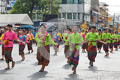 Unidentified dancers perform traditional Thai-Esan dance on the traditional candle procession festival of Buddha.