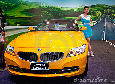 Unidentified female presenter at BMW booth Editorial Stock Image