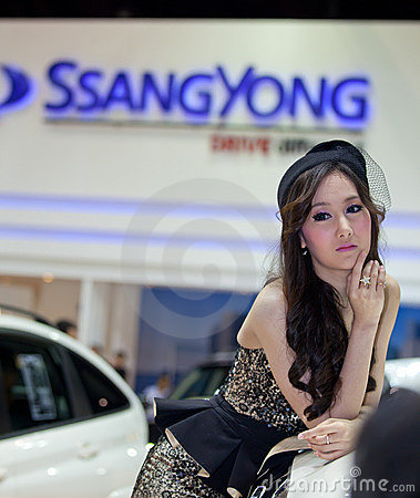 Unidentified female presenter at Ssongyong booth Editorial Stock Photo