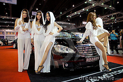 Unidentified females presenter at brabus booth Editorial Stock Photo