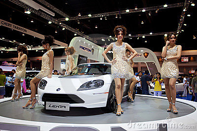 Unidentified females presenter at Proton booth Editorial Image