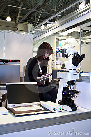 Unidentified girl reading instruction microscope Editorial Image