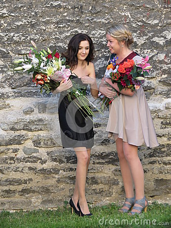 Unidentified girls with flower bouquets Editorial Photography