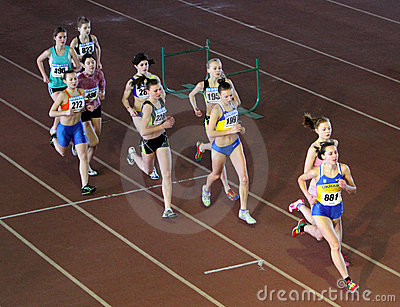 Unidentified girls run 2,000 m. steeplechase race Editorial Stock Image