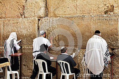 Unidentified jewish men are praying at the Wailing wall (Western wall) Editorial Image