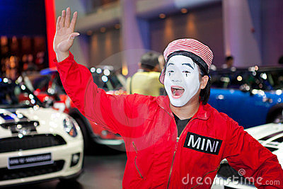 Unidentified male presenter at Mini booth Editorial Stock Image