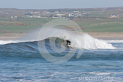 Unidentified man Surfing the Waves Editorial Stock Photo