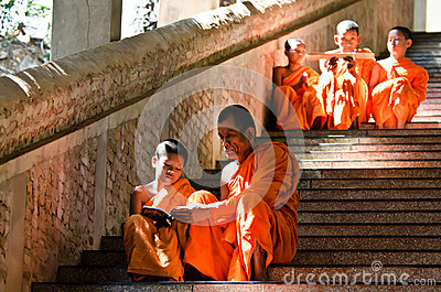 An unidentified monks teaching young novice monks Editorial Stock Image