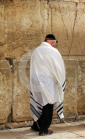 Unidentified old man in tefillin  praying at the Wailing wall (Western wall) Editorial Stock Image