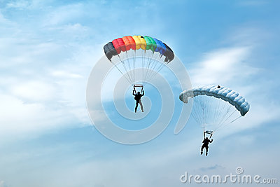 Unidentified skydivers on blue sky