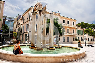 Unidentified tourists near fountain in Nimes, France Editorial Photo