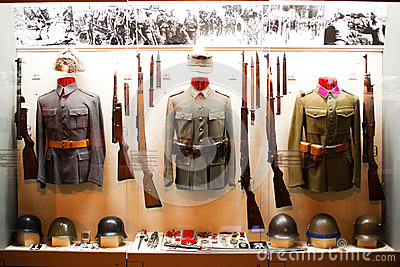 Uniforms on display in museum Editorial Stock Image