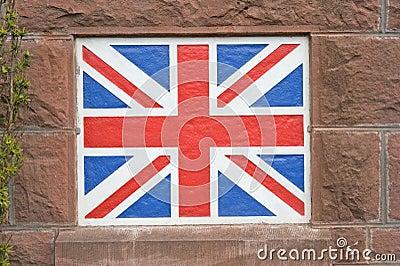 Union Jack flag painted on wall.