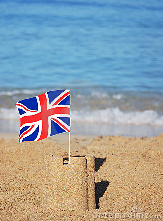 Union Jack flag on a pretty beach