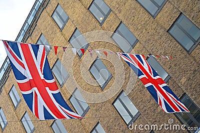 Union Jack flags hang across street
