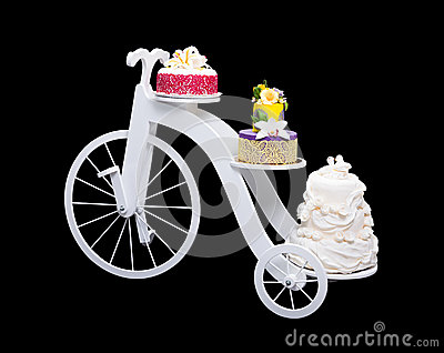 Unique bicycle cake stand with three cakes