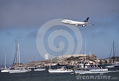 United Airline Plane flying above SF bay Editorial Stock Image
