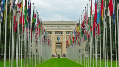 United Nations building with flags, Geneva, Switzerland, 4K stock footage