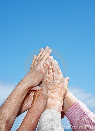 Unity - A group of hand raised against the sky
