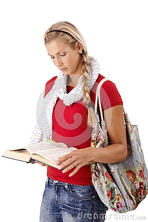 University girl reading book