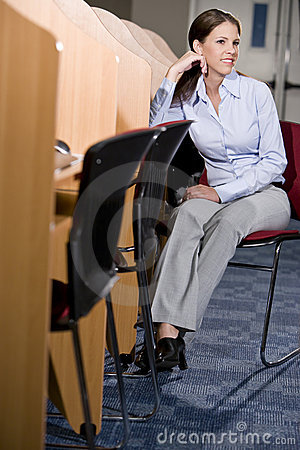 University student sitting  at library computer
