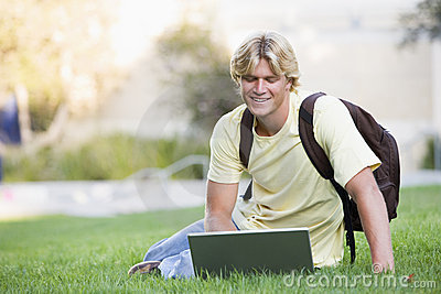 University student using laptop outside